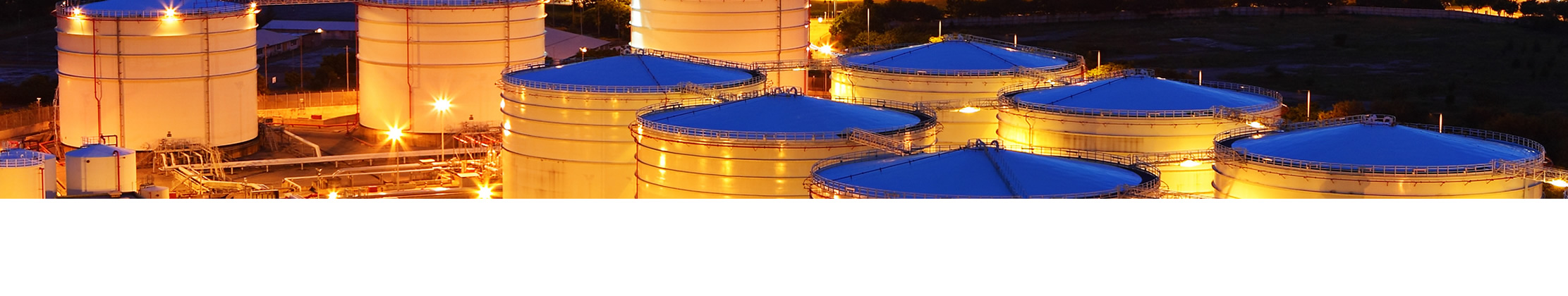 large fuel distribution tanks within the night